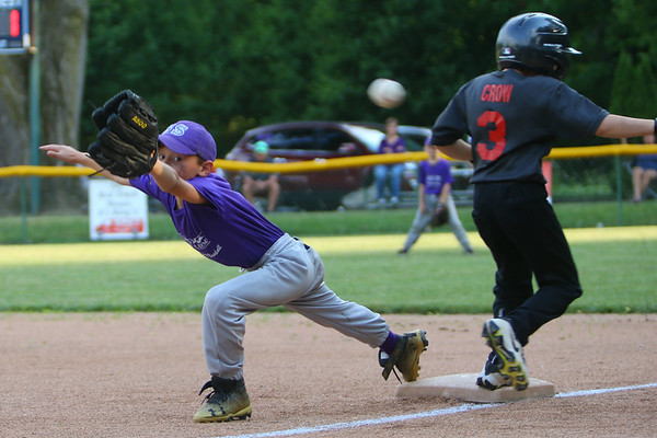 The Rookie League Championship held at UCT Park between Russiaville's Reser Hereford's and Southside's Children's Christian Academy on June 8, 2018. Children's Christian Academy's Jayland Olivares reaches for the ball as Spencer Crow tags first.<br /> Tim Bath | Kokomo Tribune