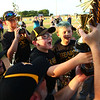 6-15-18<br /> Minor League Championship between Hearn Dental and Jarrell Orthodontics<br /> Alex Stewart, center, and the rest of Hearn Dental admire the championship trophy after their win.<br /> Kelly Lafferty Gerber | Kokomo Tribune