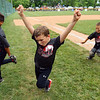 The Rookie League Championship held at UCT Park between Russiaville's Reser Hereford's and Southside's Children's Christian Academy on June 8, 2018. Jordan Bourff and his team celebrate after winning the championship.<br /> Tim Bath | Kokomo Tribune