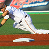 The Kokomo Jackrabbits opening game against the Lafayette Aviators on June 4, 2018. Amir Wright dives for the ball but is unable to make the throw to first. The Lafayette player, Brady Huebbe, to score later in the 4th inning.<br /> Tim Bath | Kokomo Tribune
