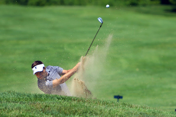 Sectional Golf at Rock Hollow in Peru on June 4, 2018.<br /> Northwestern's Bruce Cunningham chipping out of a bunker onto the 4th green.<br /> Tim Bath   Kokomo Tribune