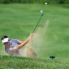 Sectional Golf at Rock Hollow in Peru on June 4, 2018.<br /> Northwestern's Bruce Cunningham chipping out of a bunker onto the 4th green.<br /> Tim Bath | Kokomo Tribune