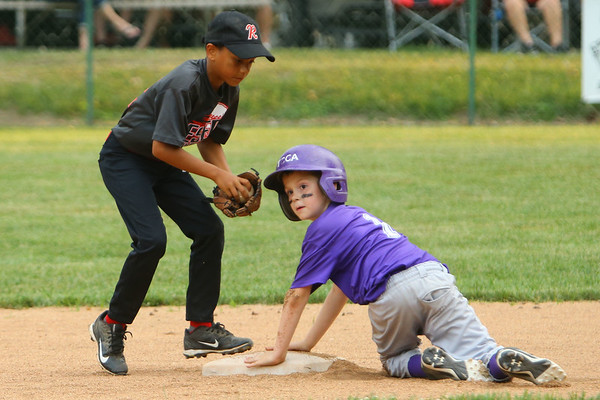 The Rookie League Championship held at UCT Park between Russiaville's Reser Hereford's and Southside's Children's Christian Academy on June 8, 2018. Dayven Rody works on the tag of CJ Haney.<br /> Tim Bath | Kokomo Tribune