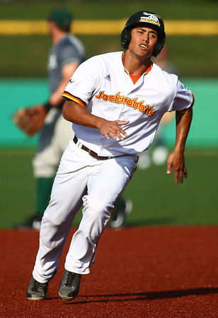 6-20-18<br /> Jackrabbits vs Dans<br /> Marcos Sanchez heads to third, and later scores the first inning run.<br /> Kelly Lafferty Gerber   Kokomo Tribune