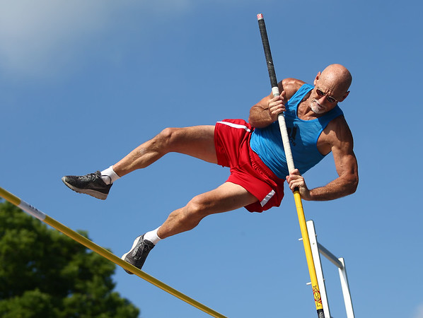 70-year-old John Large competes in the pole vault during the Haynes Apperson Sports Festival on Saturday, June 30, 2018.<br /> Kelly Lafferty Gerber   Kokomo Tribune