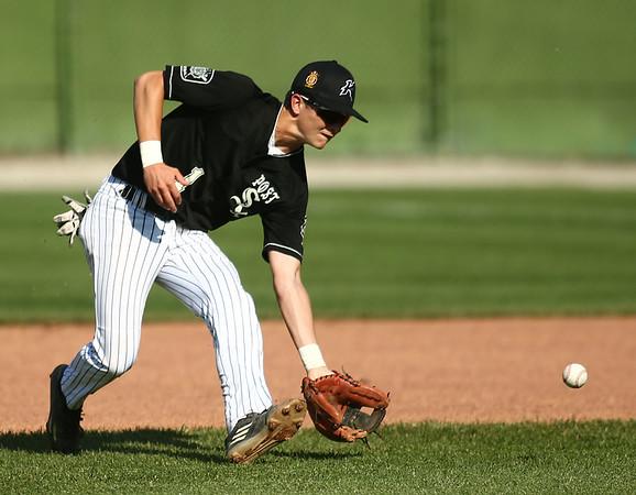 6-13-18<br /> Post Six baseball vs Napoleon<br /> Wynn Takacs scoops up the ball.<br /> Kelly Lafferty Gerber | Kokomo Tribune