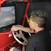 Don Knight | The Herald Bulletin<br /> Jordan Leslie, 13, tries the DAK Sprint Car Simulator before the start of the Pay Less Little 500 on Saturday.