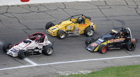Don Knight   The Herald Bulletin Aaron Pierce (26) passes race leader Davey Hamilton Jr. (1) with an inside line as the two contend with lap traffic on Saturday.