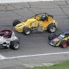 Don Knight | The Herald Bulletin<br /> Aaron Pierce (26) passes race leader Davey Hamilton Jr. (1) with an inside line as the two contend with lap traffic on Saturday.