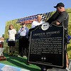 Don Knight | The Herald Bulletin<br /> Rick Dawson and Eric Gordon unviel a historical marker for the Anderson Speedway during prerace activities for the Little 500 on Saturday.