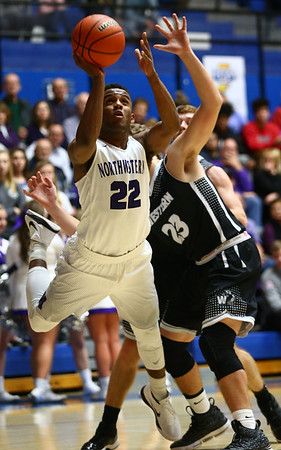 3-2-18<br /> Western vs Northwestern boys basketball<br /> Tayson Parker puts up a shot.<br /> Kelly Lafferty Gerber | Kokomo Tribune
