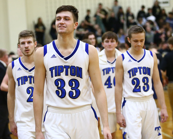 3-10-18<br /> Tipton vs Covington boys basketball regional semi-final<br /> Trent Seward smiles as he walks off the court after Tipton beat the number 1 ranked school.<br /> Kelly Lafferty Gerber | Kokomo Tribune