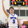 3-10-18<br /> Tipton vs Covington boys basketball regional semi-final<br /> Grant Shively raises his arm in victory as the final minute of the game rolls by.<br /> Kelly Lafferty Gerber | Kokomo Tribune