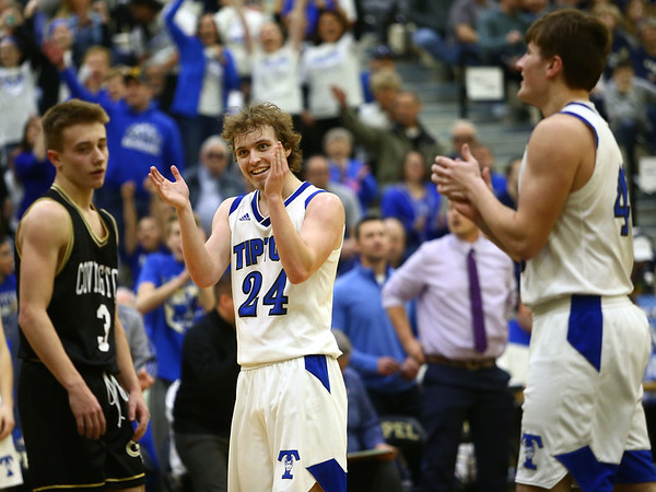 3-10-18<br /> Tipton vs Covington boys basketball regional semi-final<br /> Carson Dolezal celebrates as Tipton takes a significant lead.<br /> Kelly Lafferty Gerber | Kokomo Tribune