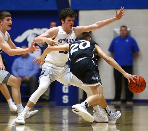3-2-18<br /> Western vs Northwestern boys basketball<br /> NW's Caleb Treadway plays defense against Western's Kyle Sanders.<br /> Kelly Lafferty Gerber | Kokomo Tribune