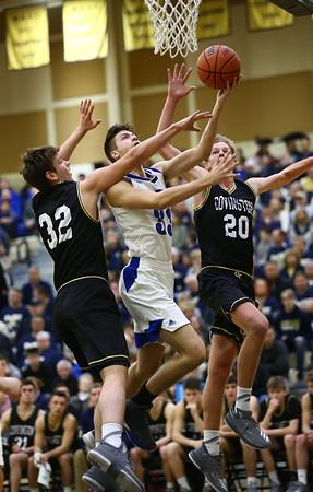 3-10-18<br /> Tipton vs Covington boys basketball regional semi-final<br /> Trent Seward puts up a shot.<br /> Kelly Lafferty Gerber | Kokomo Tribune