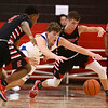 3-3-18<br /> Tipton vs Eastbrook sectional<br /> Tipton's Grant Shively, center, goes after a loose ball.<br /> Kelly Lafferty Gerber | Kokomo Tribune