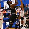 3-2-18<br /> Peru vs West Lafayette boys basketball<br /> Peru's D.J. Fuller puts up a shot.<br /> Kelly Lafferty Gerber | Kokomo Tribune