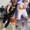 3-2-18<br /> Peru vs West Lafayette boys basketball<br /> Peru's Gavin Gysin dribbles down the court.<br /> Kelly Lafferty Gerber | Kokomo Tribune