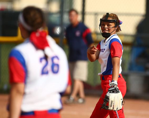 5-16-18<br /> Kokomo vs Cass softball<br /> Pitcher Lauryn Hicks congratulates Sarah Stonebraker after Stonebraker makes a good play.<br /> Kelly Lafferty Gerber | Kokomo Tribune