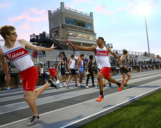 5-17-18<br /> Boys track and field sectional<br /> Kokomo's Chris Thomas hands off to Justin Taflinger in the 4x400 relay.<br /> Kelly Lafferty Gerber | Kokomo Tribune