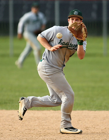 5-1-18<br /> Taylor vs Eastern baseball<br /> Eastern's Draeden Morris-Graber grabs the ball before throwing to first for an out.<br /> Kelly Lafferty Gerber | Kokomo Tribune