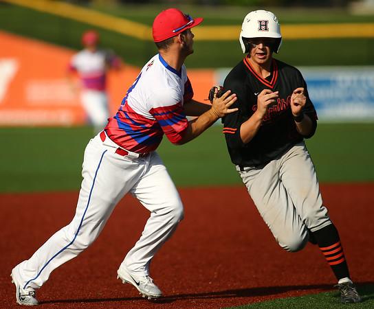 5-25-18<br /> Kokomo vs Harrison baseball<br /> Noah Hurlock tags Harrison's Nate Stansbury out on the way to third.<br /> Kelly Lafferty Gerber | Kokomo Tribune
