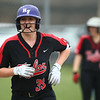 5-3-18<br /> Taylor vs Carroll softball<br /> Ruby Terrell smiles after scoring a run.<br /> Kelly Lafferty Gerber | Kokomo Tribune
