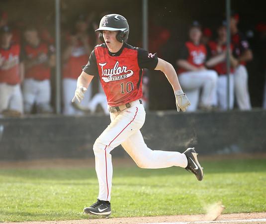 5-1-18<br /> Taylor vs Eastern baseball<br /> Taylor's Clay Brubaker runs home.<br /> Kelly Lafferty Gerber   Kokomo Tribune
