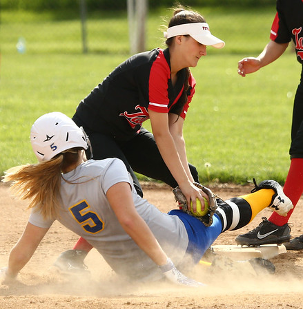 5-10-18<br /> Taylor vs TC softball<br /> Taylor's Lynzey Butzin tags TC's Shalyn McCorkle out at second.<br /> Kelly Lafferty Gerber | Kokomo Tribune