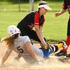 5-10-18<br /> Taylor vs TC softball<br /> Taylor's Lynzey Butzin tags TC's Shalyn McCorkle out at second.<br /> Kelly Lafferty Gerber | Kokomo Tribune