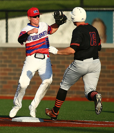 5-25-18<br /> Kokomo vs Harrison baseball<br /> Bayden Root sprints to first with the ball just in time to get Harrison's Bobby Dearing out.<br /> Kelly Lafferty Gerber | Kokomo Tribune