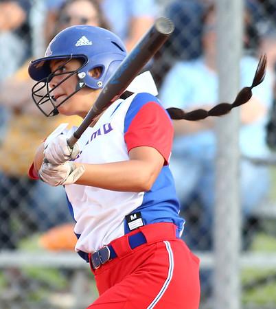 5-16-18<br /> Kokomo vs Cass softball<br /> Kokomo's Courtland Cottle bats.<br /> Kelly Lafferty Gerber | Kokomo Tribune