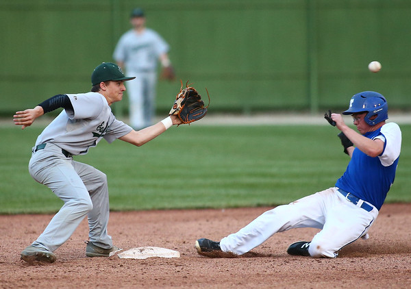 5-26-18<br /> Eastern vs Tipton baseball<br /> Tipton's Harrison Finch is safe at second before Eastern's Matthew Arcari can make the catch.<br /> Kelly Lafferty Gerber   Kokomo Tribune