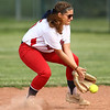 5-16-18<br /> Kokomo vs Cass softball<br /> Cass' Haley Begley scoops up the ball.<br /> Kelly Lafferty Gerber | Kokomo Tribune