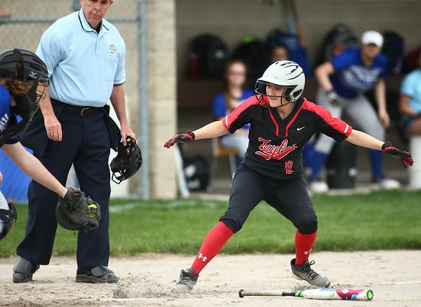 5-3-18<br /> Taylor vs Carroll softball<br /> Lynzey Butzin gets chased back to third by the catcher.<br /> Kelly Lafferty Gerber | Kokomo Tribune