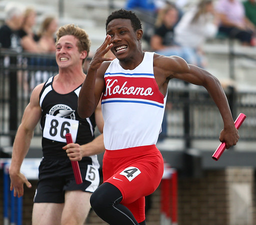 5-17-18<br /> Boys track and field sectional<br /> Kokomo's Steven Edwards runs the last leg of the 4x100 relay.<br /> Kelly Lafferty Gerber | Kokomo Tribune