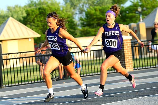 Regional Girls Track on May 22, 2018. <br /> Northwestern's Johannah Hetzner handing off to Rachel Mast running the 4x100.<br /> Tim Bath | Kokomo Tribune