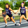 Regional Girls Track on May 22, 2018. <br /> Northwestern's Johannah Hetzner handing off to Rachel Mast running the 4x100.<br /> Tim Bath | Kokomo Tribune