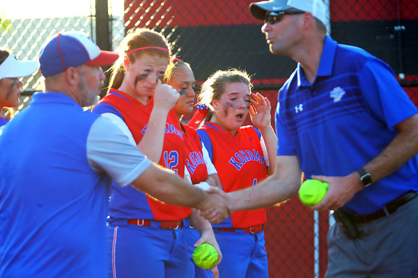 Kokomo looses the sectional finals to Harrison HS in Logansport on May 24, 2018. After the game coach Mike Susong is congradulated on the sectional runner-up with team captains Savannah Emmons, Lauryn Hicks and Katelyn Dowden receive a game ball.<br /> Tim Bath | Kokomo Tribune
