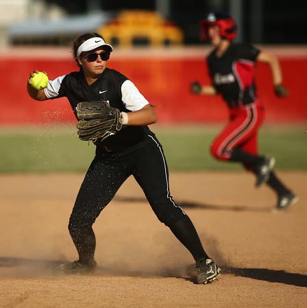5-24-18<br /> Western vs Twin Lakes softball<br /> Karlynne Shepherd throws to third for an out.<br /> Kelly Lafferty Gerber   Kokomo Tribune