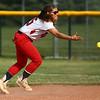 5-16-18<br /> Kokomo vs Cass softball<br /> Cass' Brannyn Spencer tosses the ball to first for an out.<br /> Kelly Lafferty Gerber | Kokomo Tribune