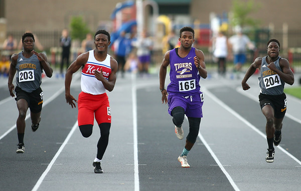 5-17-18<br /> Boys track and field sectional<br /> Kokomo's Steven Edwards and NW's Tayson Parker in the 100 meter dash finals.<br /> Kelly Lafferty Gerber   Kokomo Tribune