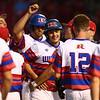 5-23-18<br /> Kokomo vs McCutcheon baseball<br /> Noah Hurlock and Kyle Wade are congratulated by teammates after scoring runs for the Wildkats.<br /> Kelly Lafferty Gerber | Kokomo Tribune