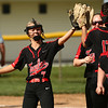 5-10-18<br /> Taylor vs TC softball<br /> Taylor's Shelby Ward high fives teammates after she makes a catch for an out.<br /> Kelly Lafferty Gerber   Kokomo Tribune