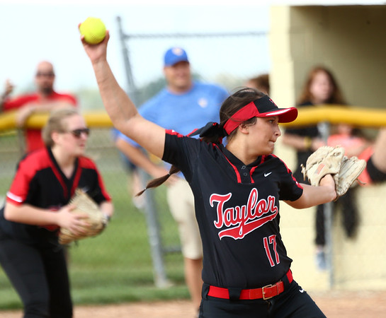 5-10-18<br /> Taylor vs TC softball<br /> Shaelah Eliason pitches.<br /> Kelly Lafferty Gerber | Kokomo Tribune