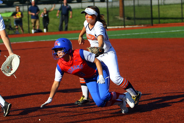 Kokomo looses the sectional finals to Harrison HS in Logansport on May 24, 2018. Olivia Branch sacrafices herself to allow Kokomo to score the first run of the game in the 2nd inning with Harrison's Kiley Goff tagging her.<br /> Tim Bath | Kokomo Tribune