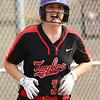 5-10-18<br /> Taylor vs TC softball<br /> Taylor's Ruby Terrell cheers as she comes off home plate, scoring a run.<br /> Kelly Lafferty Gerber   Kokomo Tribune