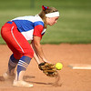 5-16-18<br /> Kokomo vs Cass softball<br /> Kokomo's Taylor Simmons scoops up the ball.<br /> Kelly Lafferty Gerber | Kokomo Tribune