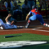 Kokomo looses the sectional finals to Harrison HS in Logansport on May 24, 2018. Harrison's Kenzie Rusk scores with the throw to catcher Katelyn Dowden coming in late.<br /> Tim Bath | Kokomo Tribune